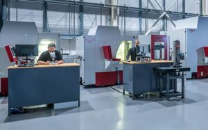GTM employees operating high spec technology for the design and development of moulds