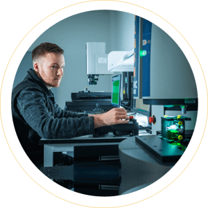 GTM employee working in the metrology lab